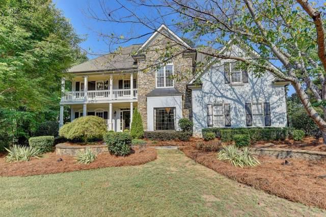 9195 Nesbit Lakes Drive, Alpharetta, GA 30022 (MLS #6628132) :: North Atlanta Home Team