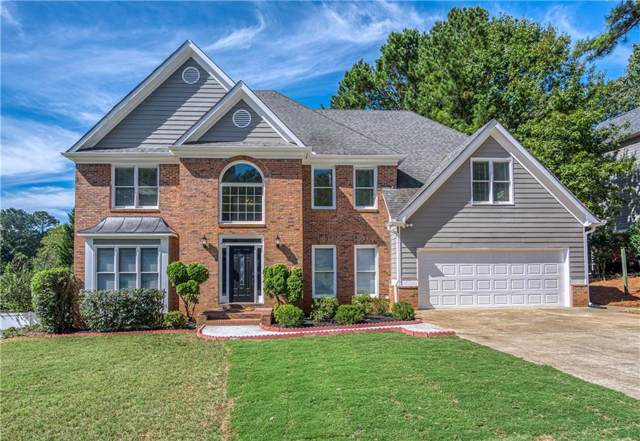 555 Fairway Drive, Woodstock, GA 30189 (MLS #6629877) :: North Atlanta Home Team
