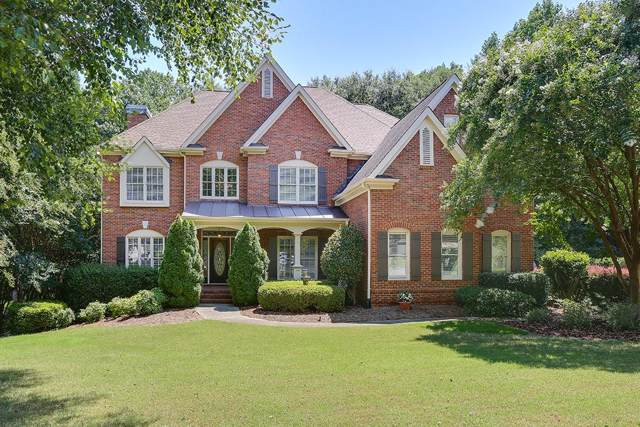 124 Riverview Drive, Suwanee, GA 30024 (MLS #6641126) :: North Atlanta Home Team