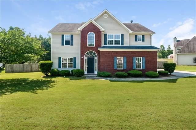 7085 Magnolia Lane, Fairburn, GA 30213 (MLS #6641936) :: Charlie Ballard Real Estate
