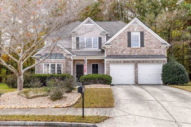 1718 Hidden Pond Circle, Lawrenceville, GA 30043 (MLS #6647019) :: North Atlanta Home Team