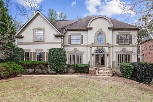 9345 Nesbit Lakes Drive, Alpharetta, GA 30022 (MLS #6667603) :: North Atlanta Home Team