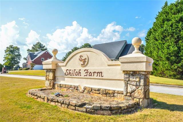 1009 Country Lane, Loganville, GA 30052 (MLS #6673578) :: The Heyl Group at Keller Williams
