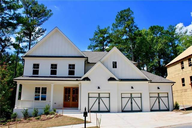 257 Harmony Lake Drive, Holly Springs, GA 30115 (MLS #6722321) :: The Zac Team @ RE/MAX Metro Atlanta