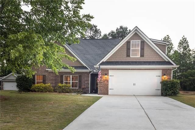 1504 Guthrie Crossing Drive, Loganville, GA 30052 (MLS #6725516) :: The Heyl Group at Keller Williams