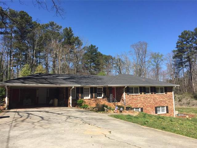 5011 Lilburn Stone Mountain Road SW, Lilburn, GA 30047 (MLS #6732970) :: North Atlanta Home Team