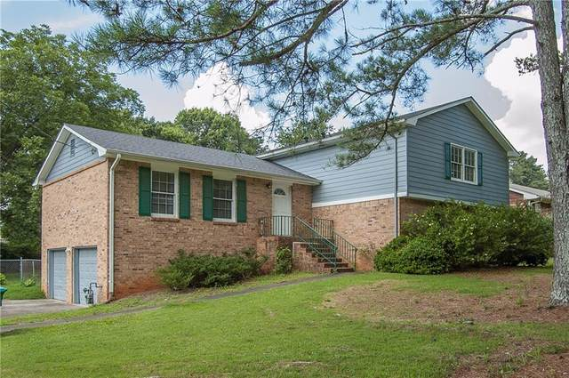 5211 Lilburn Stone Mountain Road SW, Lilburn, GA 30047 (MLS #6745011) :: North Atlanta Home Team