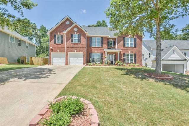 5707 Calm Valley Point, Flowery Branch, GA 30542 (MLS #6751129) :: The Heyl Group at Keller Williams