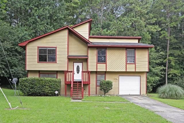 6765 Smoke Ridge, Atlanta, GA 30349 (MLS #6752289) :: The Heyl Group at Keller Williams