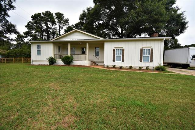 7105 Highway 92, Woodstock, GA 30189 (MLS #6758228) :: The Hinsons - Mike Hinson & Harriet Hinson