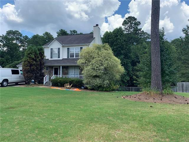 4220 Willow Springs Drive, Loganville, GA 30052 (MLS #6758583) :: The Heyl Group at Keller Williams