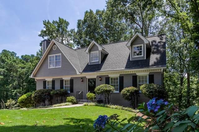 4100 W Cooper Lake Drive SE, Smyrna, GA 30082 (MLS #6762385) :: North Atlanta Home Team