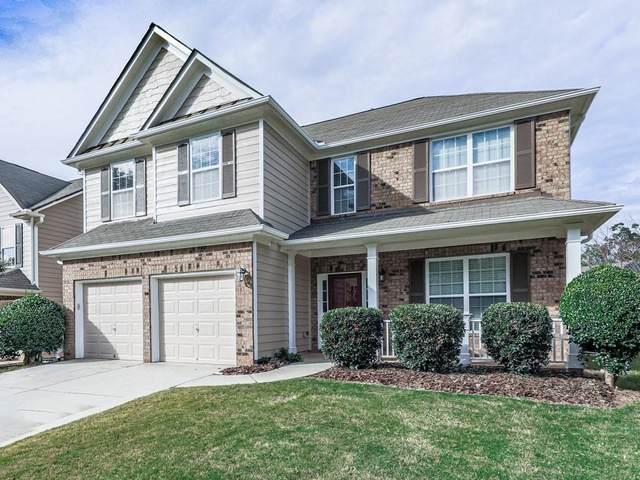 143 Hidden Lake Circle, Holly Springs, GA 30114 (MLS #6774260) :: North Atlanta Home Team