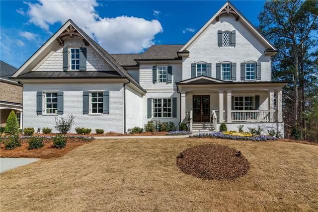223 Harmony Lake Drive, Holly Springs, GA 30115 (MLS #6777801) :: North Atlanta Home Team