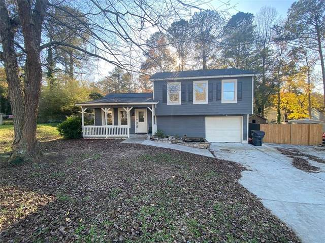 556 Burnt Creek Way NW, Lilburn, GA 30047 (MLS #6814339) :: North Atlanta Home Team