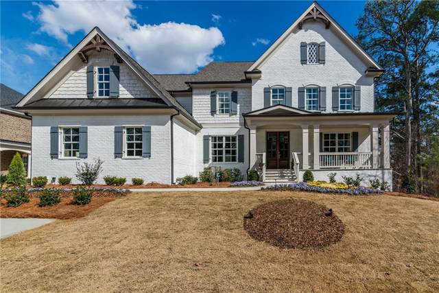 223 Harmony Lake Drive, Holly Springs, GA 30115 (MLS #6824484) :: North Atlanta Home Team