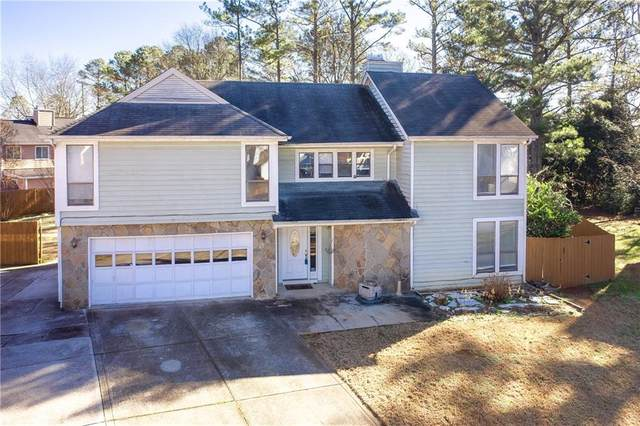 1302 Realm Lane, Lawrenceville, GA 30044 (MLS #6828856) :: Tonda Booker Real Estate Sales