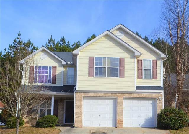 7057 Ravenwood Lane, Lithonia, GA 30038 (MLS #6830518) :: North Atlanta Home Team