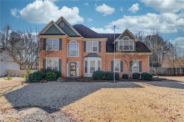 5009 Weatherstone Drive, Buford, GA 30519 (MLS #6841448) :: North Atlanta Home Team