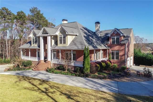 5024 Lilburn Stone Mountain Road SW, Lilburn, GA 30047 (MLS #6846583) :: North Atlanta Home Team