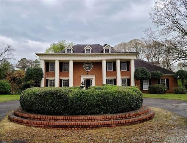 1216 Pleasant Hill Road, Lawrenceville, GA 30044 (MLS #6859923) :: RE/MAX Prestige