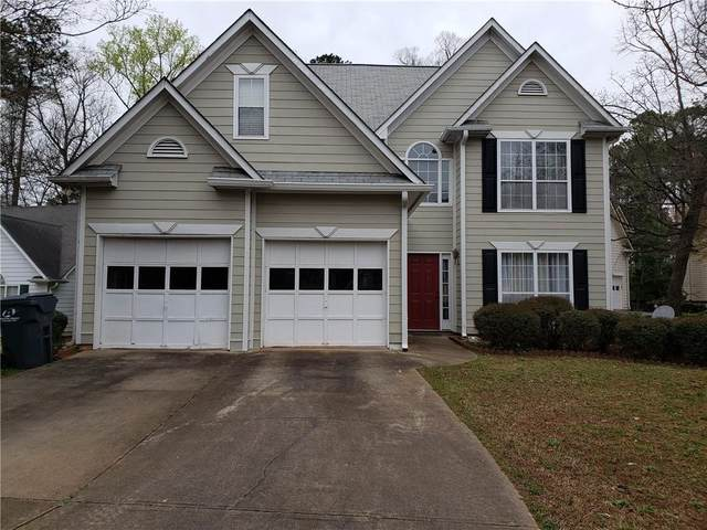 5075 NW Remington Court NW, Lilburn, GA 30047 (MLS #6861592) :: North Atlanta Home Team