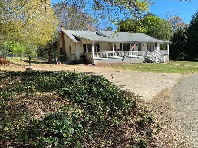 2214 Buford Dam Road, Buford, GA 30518 (MLS #6864189) :: North Atlanta Home Team