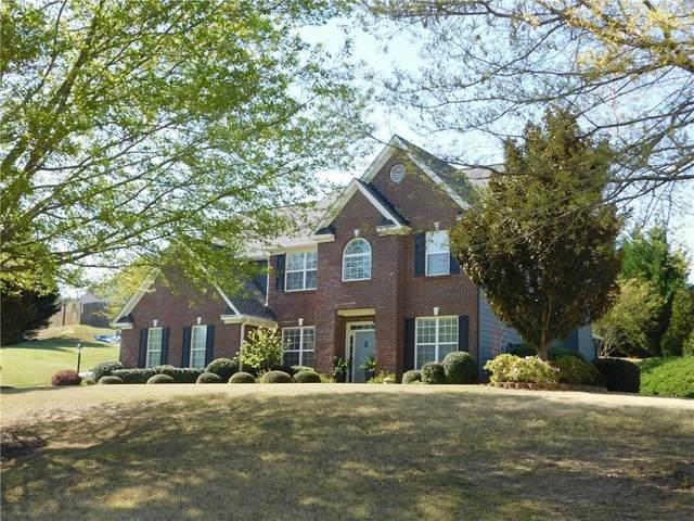 933 Cruce Lake Drive, Hoschton, GA 30548 (MLS #6868663) :: Maria Sims Group