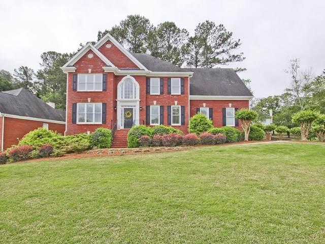 1320 Denmark Drive SW, Lilburn, GA 30047 (MLS #6880195) :: North Atlanta Home Team