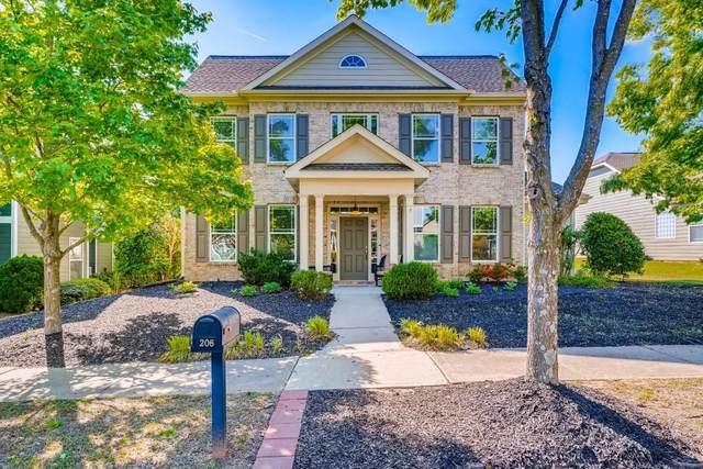 206 Harmony Lake Drive, Holly Springs, GA 30115 (MLS #6882815) :: The Kroupa Team | Berkshire Hathaway HomeServices Georgia Properties