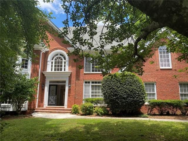 5680 Commons Lane, Johns Creek, GA 30005 (MLS #6894863) :: North Atlanta Home Team