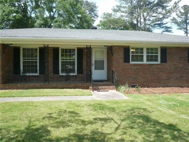3015 NE Robinson Road NE, Marietta, GA 30068 (MLS #6905666) :: Dillard and Company Realty Group