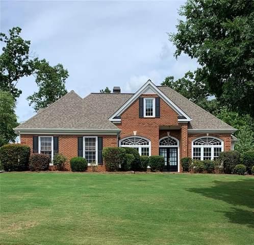 3999 Treemont Lane, Suwanee, GA 30024 (MLS #6905704) :: Dillard and Company Realty Group