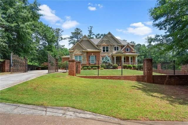 211 N River Drive SW, Lilburn, GA 30047 (MLS #6907407) :: North Atlanta Home Team