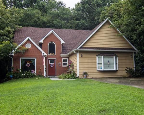 1404 Oak Knoll Drive NE, Conyers, GA 30012 (MLS #6908078) :: Todd Lemoine Team