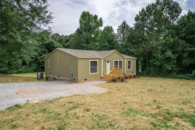 1090 River Woods Drive, Madison, GA 30650 (MLS #6911361) :: AlpharettaZen Expert Home Advisors