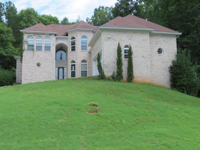 395 Falcon Ridge Drive, Fayetteville, GA 30214 (MLS #6916415) :: North Atlanta Home Team