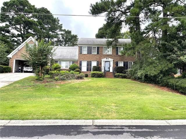 4011 Colonial Drive SW, Lilburn, GA 30047 (MLS #6937944) :: North Atlanta Home Team