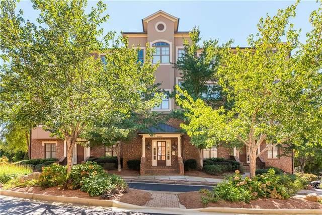 6060 City Walk Lane #302, Sandy Springs, GA 30328 (MLS #6948333) :: Dillard and Company Realty Group