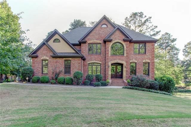 1128 Mccoy Drive, Conyers, GA 30094 (MLS #6951522) :: North Atlanta Home Team