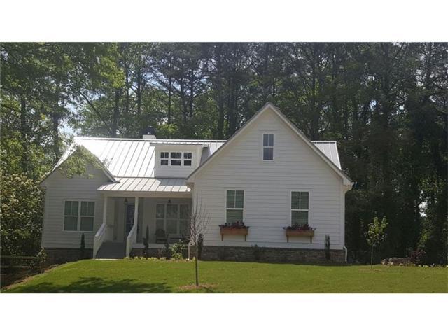 14180 Cogburn Road, Milton, GA 30004 (MLS #5821689) :: North Atlanta Home Team