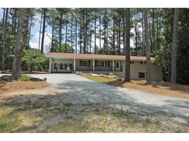 7997 Hickory Flat Highway, Woodstock, GA 30188 (MLS #5852710) :: North Atlanta Home Team