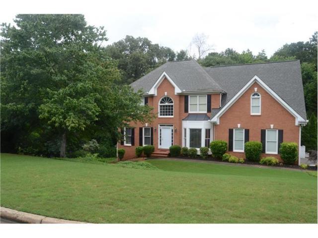1260 Pond Springs Trace SW, Lilburn, GA 30047 (MLS #5867297) :: North Atlanta Home Team