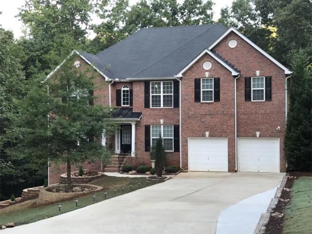 5520 Raccoon Hollow, Flowery Branch, GA 30542 (MLS #5902524) :: North Atlanta Home Team