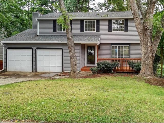 910 Singing Hills Drive, Roswell, GA 30076 (MLS #5907393) :: North Atlanta Home Team