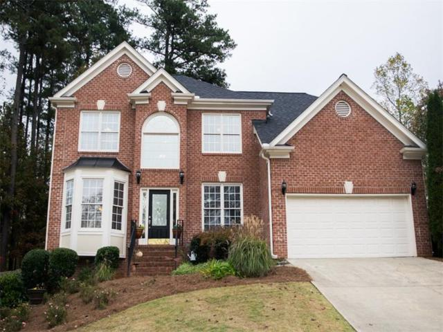 3850 Ridge Point Drive, Suwanee, GA 30024 (MLS #5935572) :: Buy Sell Live Atlanta