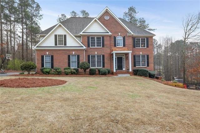 1004 Creek Side Drive, Canton, GA 30115 (MLS #5978090) :: Path & Post Real Estate