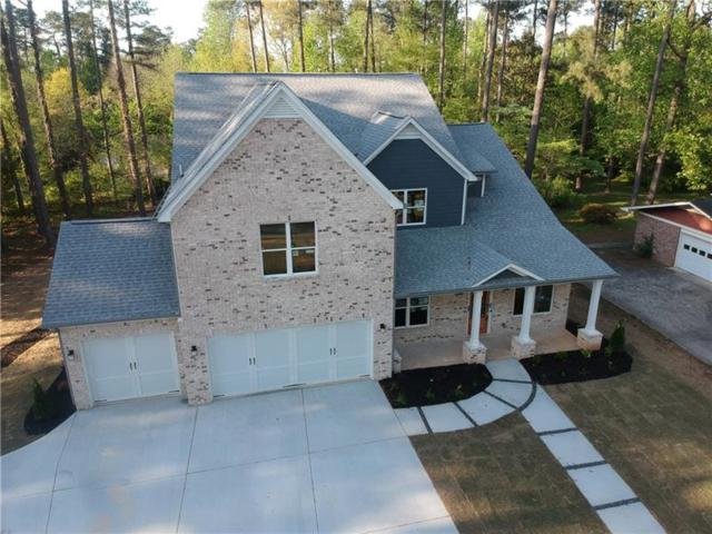 2408 Peeler Road, Dunwoody, GA 30338 (MLS #5996938) :: North Atlanta Home Team