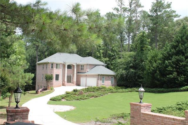 3209 Wood Springs Court SW, Lilburn, GA 30047 (MLS #6019379) :: North Atlanta Home Team