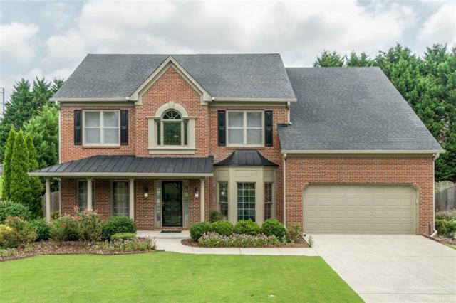 11065 Regal Forest Drive, Johns Creek, GA 30024 (MLS #6050173) :: North Atlanta Home Team